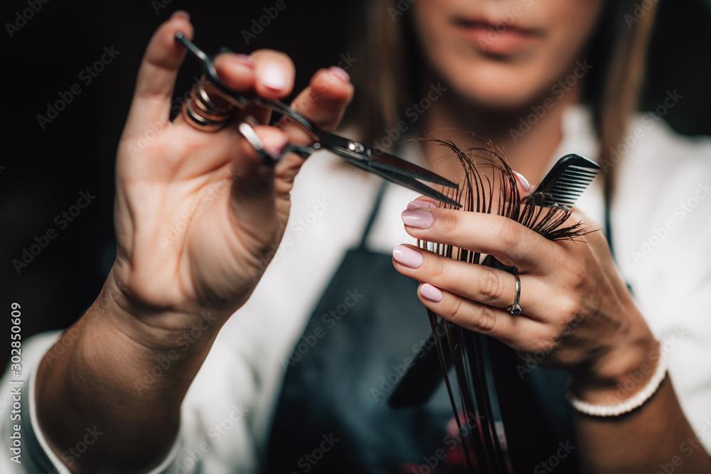 Fototapeta Cutting Hair in Beauty Salon