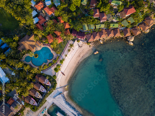 Obraz Aerial: Above  beachfront resort with sea view on beautiful tropical island koh Phangan, Haad Rin area  - fototapety do salonu