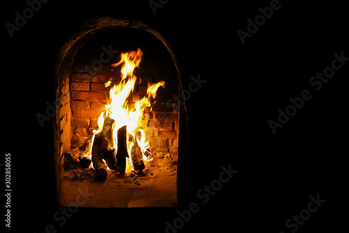 Fotobehang Brandhout textuur Indoor Fire place for decor purposes at corporate Christmas Gala Event Party