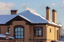 Brick House With Snow On The R...