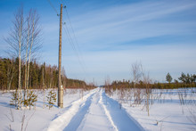 Winter Road Along The Power Line