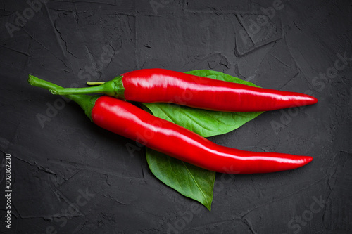 Foto op Aluminium Hot chili peppers Red hot chili peppers on a dark background
