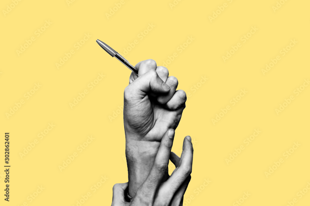Fototapety, obrazy: Concept of freedom of speech and information, stop censorship. Hand holding an open pen. It is dragged down by another hand. Black and white subject with a yellow background