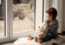 Cute Little Toddler Boy Sittin...