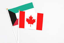 Canada And Kuwait Stick Flags On White Background. High Quality Fabric, Miniature National Flag. Peaceful Global Concept.White Floor For Copy Space.