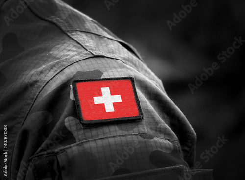 Obraz Flag of Switzerland on military uniform. Swiss flag on soldiers arm. Armed Forces, Army. Collage. - fototapety do salonu