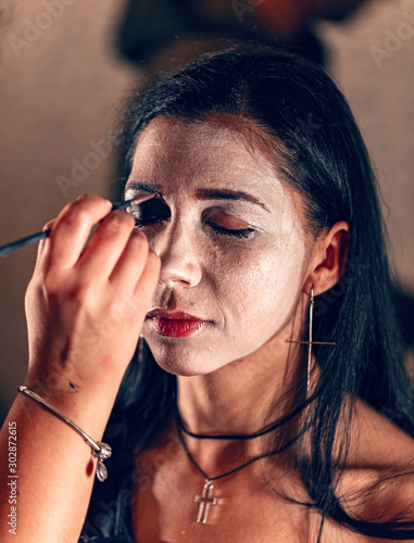 Make up artist painting face #302872615