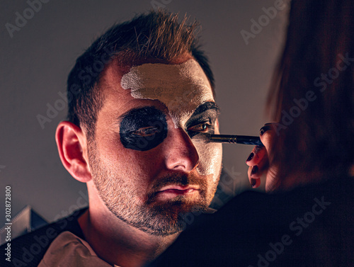 Female make up artist painting face #302872800