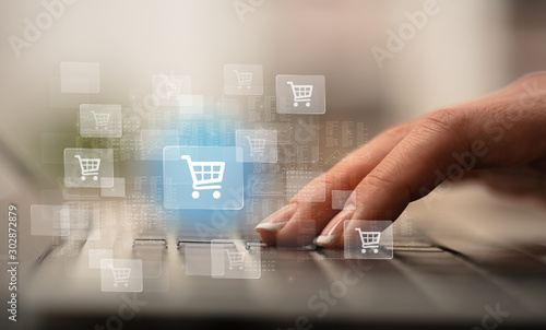Business woman hand typing on keyboard with online shopping concept Fototapeta