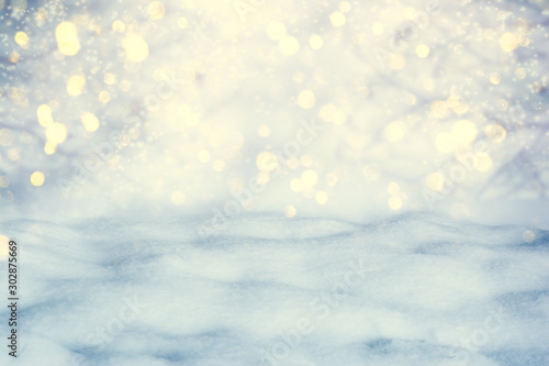 Foto auf Leinwand Weiß Winter scenic background. Christmas snow landscape with snow drifts and golden lights bokeh. Copy space. Falling snow on nature outdoors close-up. Soft vintage pastel toned