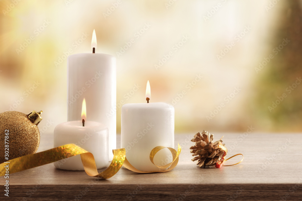 Fototapety, obrazy: Christmas religious holiday card with burning candles in room