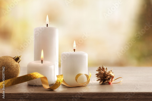 Obraz Christmas religious holiday card with burning candles in room - fototapety do salonu