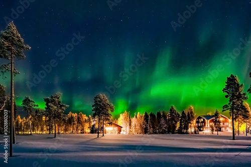 Fond de hotte en verre imprimé Aurore polaire Aurora borealis (also known like northern or polar lights) beyond the Arctic Circle in winter Lapland.