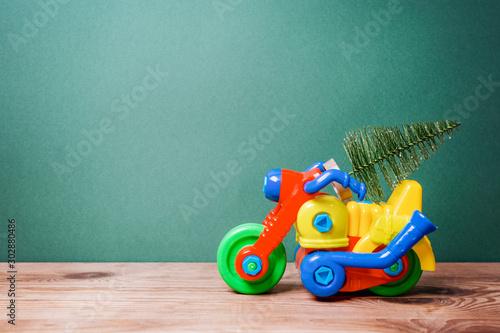Christmas tree on toy motorbike.