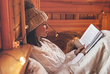 Girl Relaxing And Reading Book...