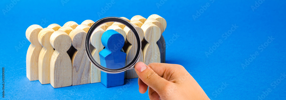Fototapeta A team of workers on a blue background. The concept of personnel selection and management within the team. Dismissal and hiring people to work. Human Resource Management. Headhunting. Talented worker