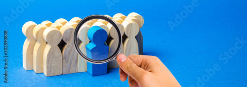 Fototapeta A team of workers on a blue background. The concept of personnel selection and management within the team. Dismissal and hiring people to work. Human Resource Management. Headhunting. Talented worker obraz