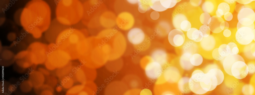 Fototapeta Golden abstract background with blurry bokeh circles. The atmosphere of the holiday and luxurious magic.