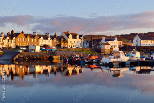 Fotografie, Tablou A view of the rocky shore of a small town Port Ellen at sunrise