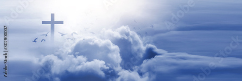 Christian cross appeared bright in the sky with soft fluffy clouds, white, beautiful colors Fototapet