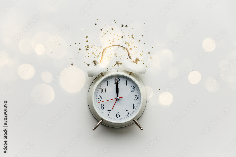 Fototapety, obrazy: Flat lay composition with alarm clock and golden stars confetti on white background
