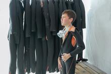 Boy Measures The Diving Suit A...