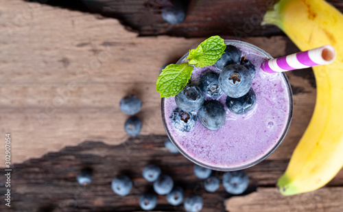 Blueberry mix banana smoothie purple colorful fruit juice milkshake blend beverage healthy high protein the taste yummy In glass,drink episode morning on a wooden background from top view Wallpaper Mural