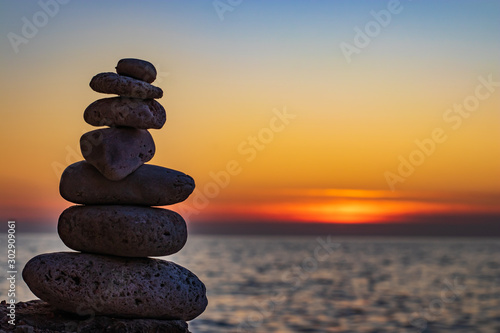 Zen concept. The object of the stones on the beach at sunset. Harmony & Meditation. Zen stones.