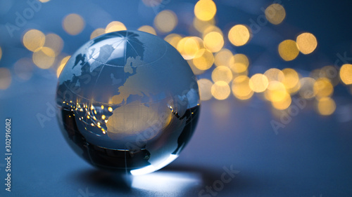 European Union on a glass ball in front of shining lights
