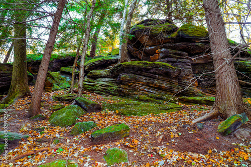 Mountain trail inside the forest. Beautiful scenic view,landscape. Roots of trees and stones on path in wild wood.Peninsula Ohio .