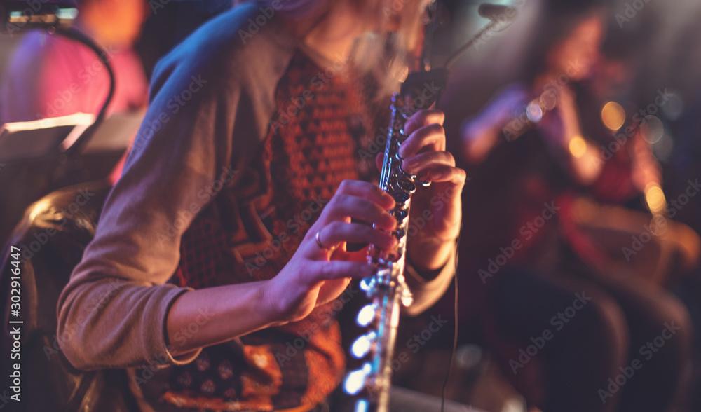 Fototapeta woman playing flute