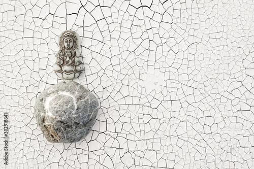 Buddha and Enso Circle Stone on cracked white background. Canvas Print