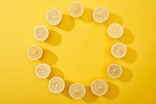 Ripe Cut Lemons On Wooden Cutting Board On Yellow Background
