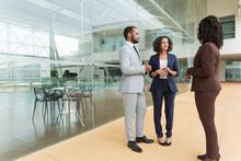 Interracial Business Team Disc...