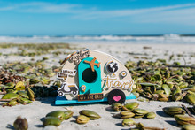 Homemade Crafty Travel Trailer On Sunny New Smyrna Beach, Florida.