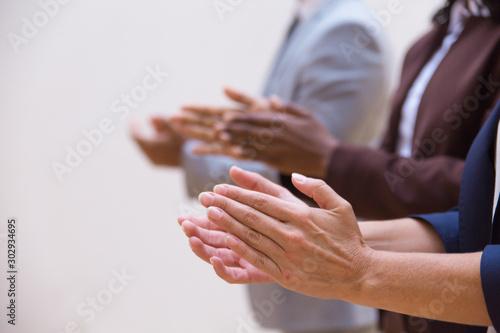 Hands of business colleagues applauding speaker Wallpaper Mural
