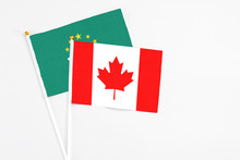 Canada And Macao Stick Flags On White Background. High Quality Fabric, Miniature National Flag. Peaceful Global Concept.White Floor For Copy Space.