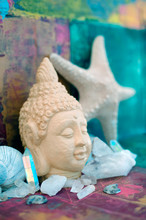 Angel Aura Quartz Crystal Point With Buddha And Seashell In A Colorful Sacred Meditation Yoga Alter.