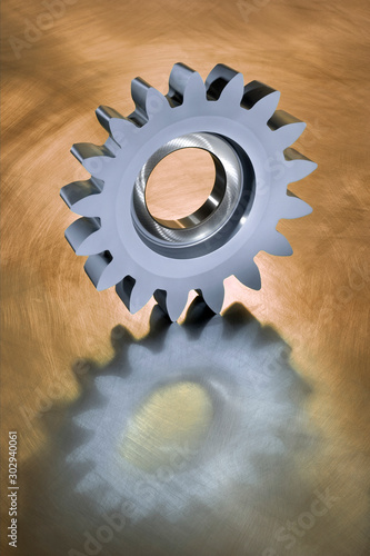 Photo  High precision gear wheel tool on a shiny background