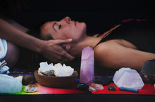 Crystal Healer's Hands Holding The Head Of A Woman Client.