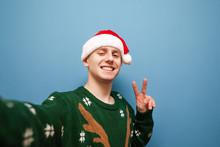 Smiling Young Man In Santa Hat...