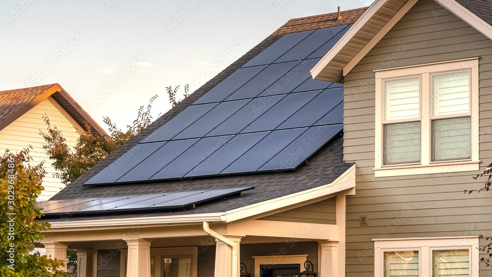 Fototapety, obrazy: Panorama frame Solar photovoltaic panels on a house roof