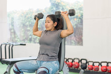 Indigenous Fitness Woman Lifting Dumbbells Exercise At The Gym