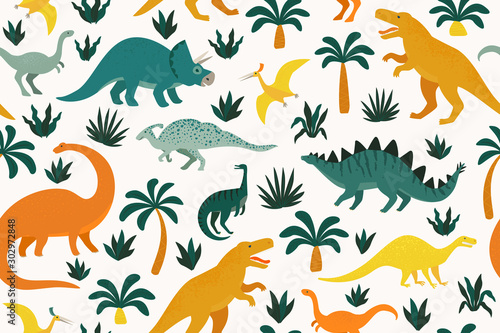 Photo Hand drawn seamless pattern with dinosaurs and tropical leaves and flowers