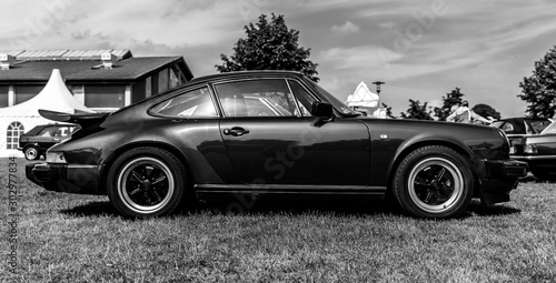 Leinwand Poster PAAREN IM GLIEN, GERMANY - MAY 19, 2018: Sports car Porsche 911 Carrera RS, 1973