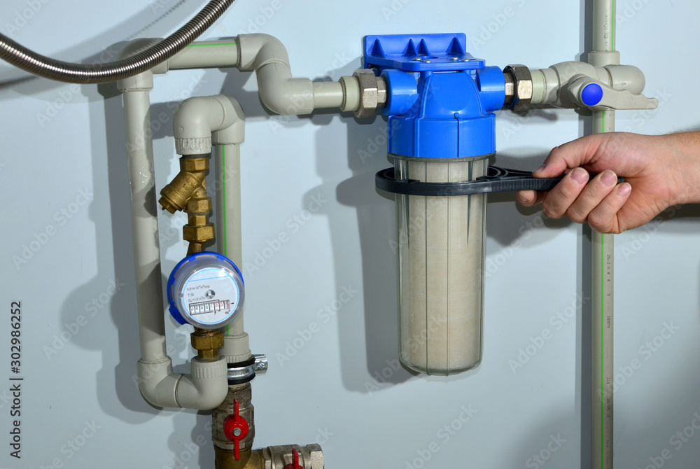 Fototapeta Mounting of house rainwater filter system. Borehole drilling and water treatment. Water filtration. Osmosis deionization system. Water treatment Appliances, ultrafiltration background