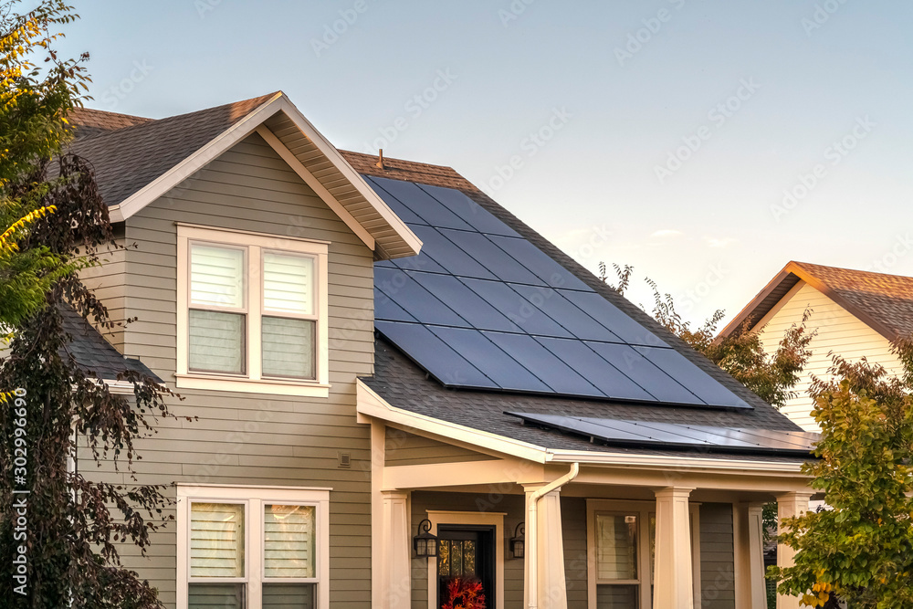Fototapety, obrazy: Solar photovoltaic panels on a house roof