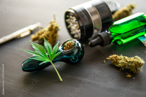Cannabis buds weed on black wood background Canvas Print