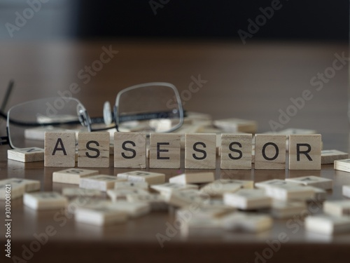 Photo Assessor the word or concept represented by wooden letter tiles