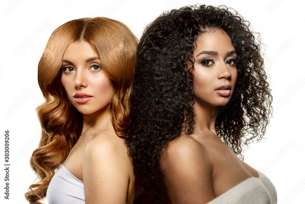 Fototapeta Multi-ethnic beauty. Caucasian and African. Different ethnicity women on white background. Beautiful vogue girls.